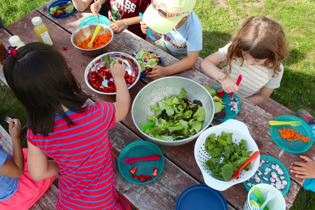 Kids make salad from spring garden harvest (Rebekah Carter 2016)